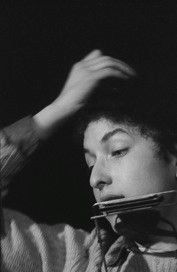 Bob Dylan adjusting his cap, Gerde's Folk City, NYC 1961