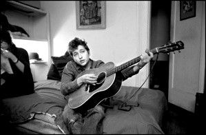 Bob Dylan playing guitar on his bed, Greenwich Village, NYC 1961